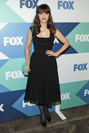 Zoeey' little black dress had a chic studded bust and full skirt for a playful look at the Fox All-Star party.