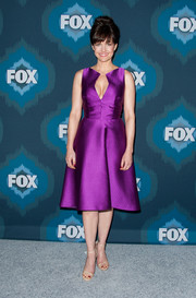 Carla Gugino totally turned heads at the Fox All-Star party in a cleavage-revealing cocktail dress in an electrifying purple hue.