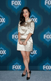 A matching mini skirt completed Maya Erskine's outfit.