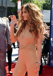 Jennifer Lopez paired her sequined jumpsuit with 18-karat yellow and black gold bracelets with pave diamonds.