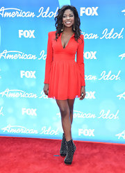 Amber Holcomb opted for a bold red frock on the red carpet of the 'American Idol' results show.