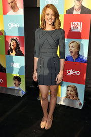 Jayma paired her nude peep-toe pumps with a fitted charcoal dress.