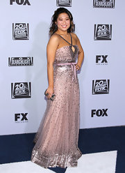 Jenna Ushkowitz accented er stunning beaded gown with a tiny metallic clutch.