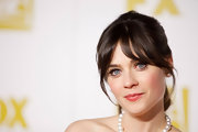 Poppy pink lips rounded out Zooey's retro look.