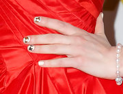 Leave it to Zooey Deschanel to sport some adorable digits at an awards show! The actress wore these mini film reels on her nails at the 2013 Golden Globe Awards.