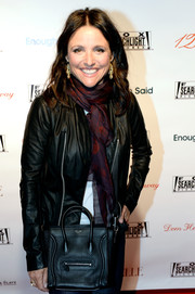 Julia Louis-Dreyfus bundled up in a black leather jacket and a patterned scarf for the Fox Searchlight TIFF party.