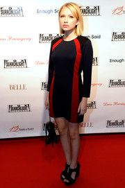 Tavi Gevinson amped up the retro feel with a pair of black T-strap platform sandals.