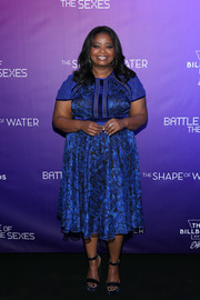 Octavia Spencer matched her dress with a pair of blue platform sandals by Jimmy Choo.
