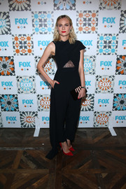 Diane Kruger went for modern drama at the Fox Summer TCA All-Star Party in a black Marios Schwab one-sleeve jumpsuit featuring a see-through lace midriff panel and a train.
