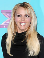 Britney was all smiles at the 'X-Factor' party with these choppy bangs and super-straight layers.