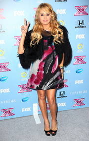 Paulina Rubio layered a black fur jacket over her print dress for a chicer finish during the 'X Factor' finalist party.