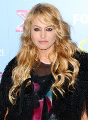 Paulina Rubio sported flowing waves and side-swept bangs at the 'X Factor' finalist party.