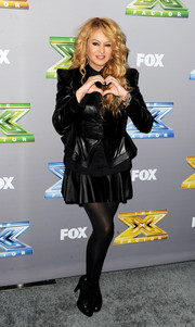 Paulina Rubio attended the 'X Factor' season finale wearing a fierce black leather jacket with pointy shoulders and a peplum silhouette.