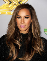 Leona Lewis played down her kissers with a subtle pink lip color.