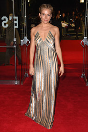 Sienna Miller gave a slinky silhouette in a stripy metallic dress by Galvan at the London premiere of 'Foxcatcher.'