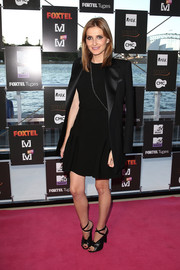 Kate Waterhouse layered a black tux jacket over an LBD for a refined look during the Foxtel Music Channels summer launch.