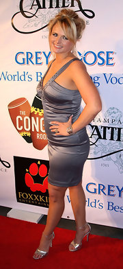 Miranda paired a pewter satin dress with silver metallic strappy sandals.