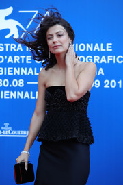 Alessandra Mastronardi matched a black velvet clutch with a strapless peplum dress for the Franca Sozzani Award.