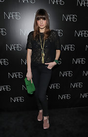 Lake Bell introduced a splash of color to her monochromatic look with an emerald green suede clutch.