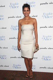 Halle Berry paired a simple strapless dress with delicate strappy sandals. The black heels kept Halle's look minimalist and chic.