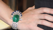 Debra Messing added quite an accessory to her wrist while visiting Fred Leighton during Fashion's Night Out in New York. The diamond, sapphire and emerald bracelet was a showstopper.
