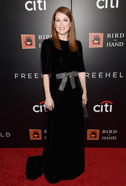 Julianne Moore was sweet and elegant at the New York premiere of 'Freeheld' in a black Saint Laurent velvet gown with a metallic bow along the waist.