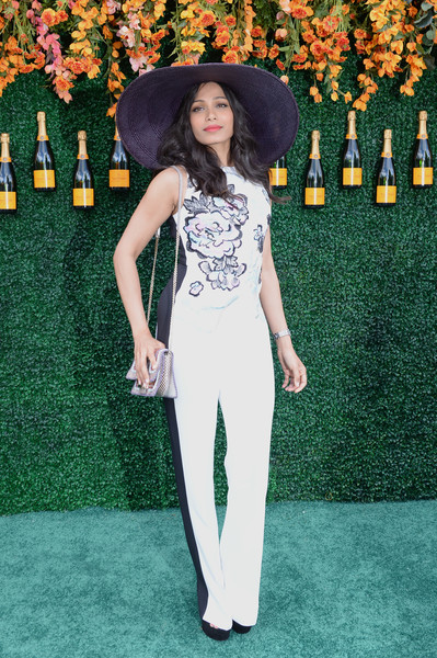 Freida Pinto Jumpsuit [clothing,green,red carpet,carpet,fashion,formal wear,suit,pantsuit,dress,flooring,arrivals,freida pinto,jersey city,new jersey,liberty state park,veuve clicquot polo classic]