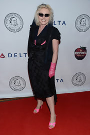 Debbie Harry may have sported a basic LBD, but her look was anything but basic. The punk rocker sported vibrant pink gloves, shoes, and camisole to add some funky flare.