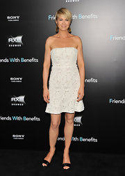 Jenna Elfman opted for a summery white lace frock and black evening sandals for the Friends with Benefits premiere. The actress continues to don her punk pixie cut and accessorized with gold shoulder-duster earrings.