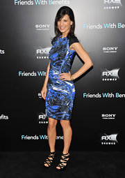 Actress Perrey Reeves rocks a blue graphic dress at the New York premiere of 'Friends with Benefits.' She pairs the look with black strappy heels and gold bracelets from David Yurman.