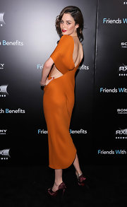 Nicole Trunfio looked absolutely refined in an orange silk cut-out dress at the 'Friends with Benefits' premiere. The brunette bombshell posed confidently and completed her style with red lips and maroon satin heels.