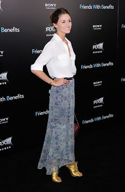 Olivia Palermo was another fashionable attendee at the Friends with Benefits NY premiere. The fashion maven opted to wear a paisley print maxi-skirt with a casual white button-down blouse. The starlet wore her hair back in an easy updo and stepped out in gold Giuseppe Zanotti heels.