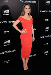 Mila Kunis and Justin Timberlake hit up the red carpet in New York last night for their latest movie, 'Friends with Benefits.' Mila looked ravishing in an off-the-shoulder red knit Lanvin dress. It doesn't get hotter than this, folks!