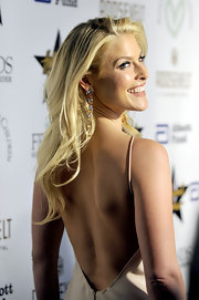Ali paired her nude silk dress with her long blonde curls.