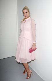 Amber Le Bon kept it modest and sweet in a long-sleeve pink midi dress at the Bora Aksu fashion show.