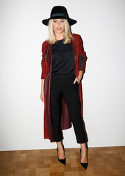 Underneath her coat, Mollie King sported simple black capri pants and a matching blouse.