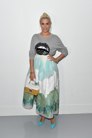 Amber Le Bon kept it fun in a lip-print gray sweater by Markus Lupfer at the Antonio Berardi fashion show.
