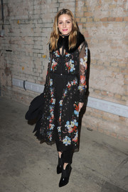 Olivia Palermo channeled spring in a floral frock by Roberto Cavalli during the Erdem fashion show.
