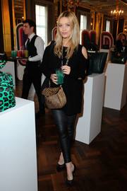 Laura Whitmore styled her black look with a leopard-print shoulder bag.