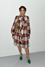 Yasmin Le Bon went conservative in a long-sleeve plaid dress by Antonio Berardi when she attended the label's fashion show.