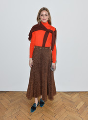 Olivia Palermo played with colors, teaming her red top with teal smoking slippers by Santoni.