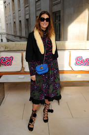 Yasmin Le Bon spiced up her outfit with a pair of pompom-embellished lace-up pumps.