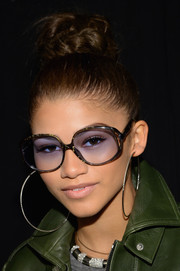 Zendaya Coleman looked funky with her braided top bun during the Rebecca Minkoff fashion show.