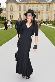 Mouna Ayoub cut a shapely silhouette in her black mermaid gown during the Dior Couture fashion show.