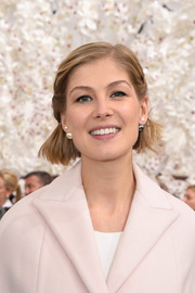 Rosamund Pike fixed her short locks into a half-up style for a youthful look during the Dior Couture fashion show.