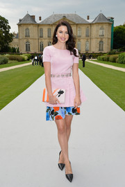 Emma Miller continued the pink floral theme with a rose-print clutch by Dior.