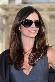 Christina Pitanguy added a sporty touch with a pair of designer shield sunglasses.