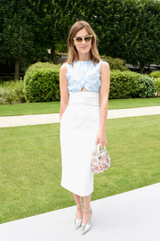 Hanneli Mustaparta attended the Dior Couture show looking stylish in a pastel-blue cutout top from the label.