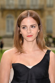 Emma Watson sported a casual center-parted hairstyle at the Dior Couture fashion show.