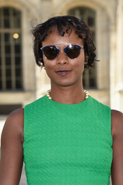 Shala Monroque went to the Dior show wearing ultra-modern round sunnies with geometric blue frames.